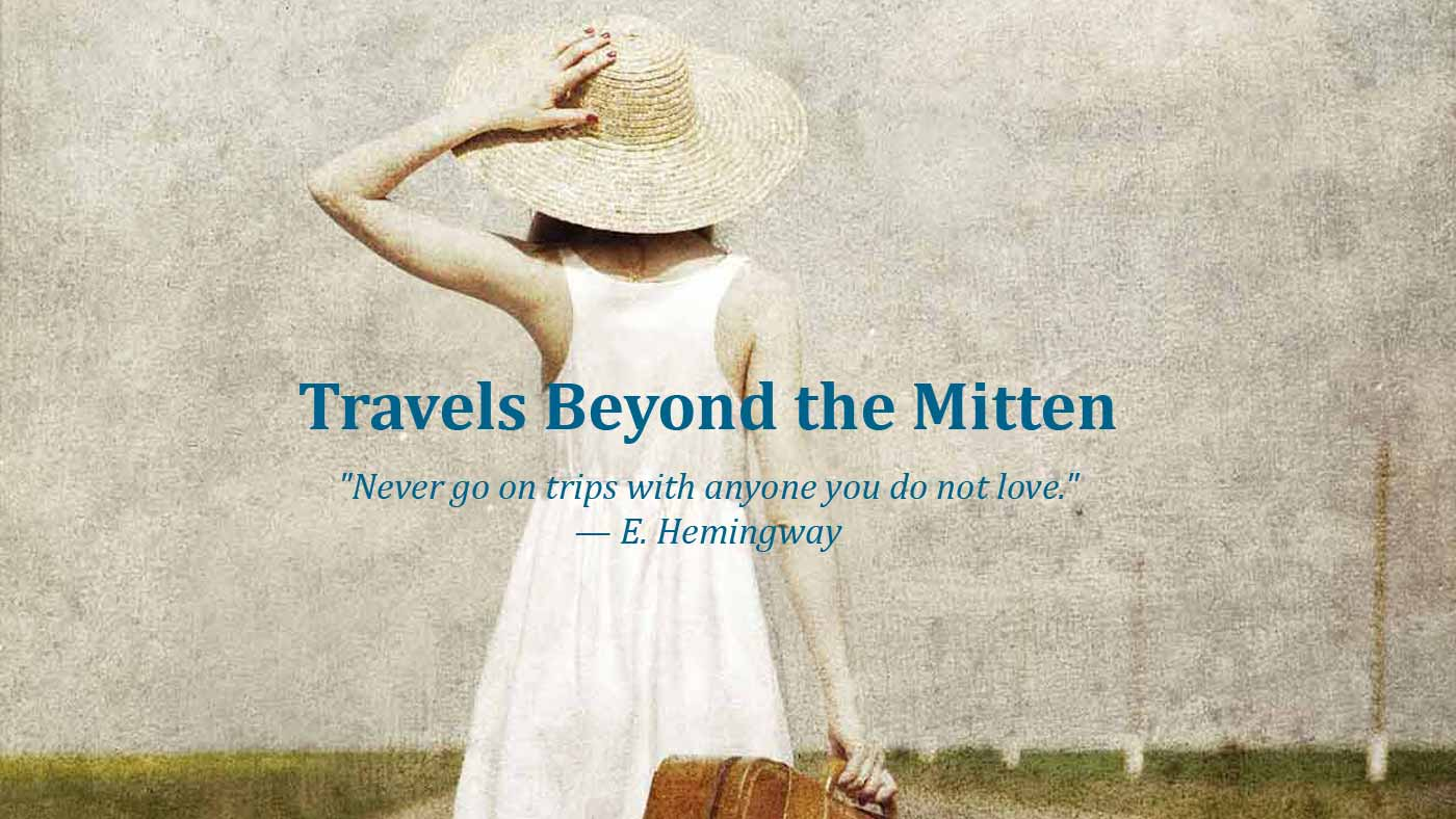 travels beyond the mitten girl with suitcase